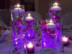 Light Up Centerpiece table decor is easier to make than one might think! Beautiful use of LED submersible lights - put them in vase base, then add gems & jewels, flowers on top of that, then floating candles to complete look. Here's the LEDs to use: http://www.flashingblinkylights.com/ledsubmersiblecraftlights-c-114_462.html?utm_source=Pinterest&utm_medium=LED%20Submersibles&utm_campaign=Wedding%20Decor