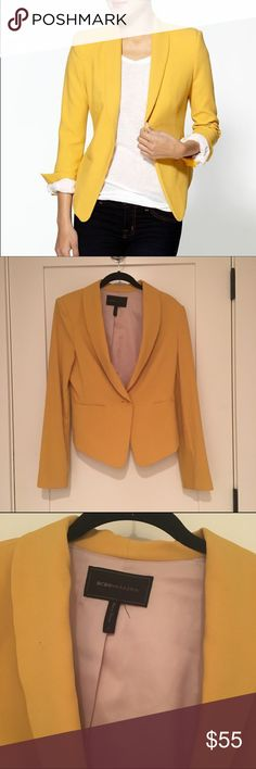 NWOT BCBG Max Azria Yellow Bowie Jacket NWOT authentic BCBG Max Azria yellow Bowie jacket! Never been worn, and shows no signs of wear! Comes from a smoke free home.  Curved collar. Lapels. Long sleeves. Front welt pockets. Button detail at cuffs. Ponte insets at sleeves. Shoulder pads. Single front button closure. Ponte: Polyester, Rayon, Spandex. Lining: Cotton, Nylon, Spandex. Dry Clean. BCBGMaxAzria Jackets & Coats Blazers