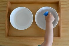 easy at home water play- transferring water with sponges, basters, and funnels