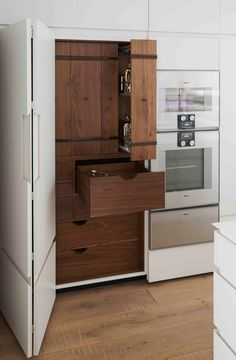 Bespoke contemporary larder design with walnut interior and folding door Kitchen designed by British luxury furniture makers McCarron 038 Co Furniture Ads, Simple Furniture, White Furniture, Upcycled Furniture, Furniture Makers, Luxury Furniture, Furniture Makeover, Folding Furniture, Bedroom Furniture