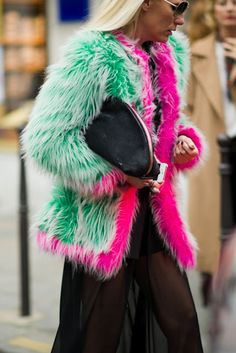 Not sure about this...but there's something....  Green #fur coat with hot pink lining.   #Party www.foxandklaff.com