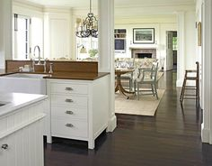 This opening between kitchen and dining room is similar to my idea to open ours up.