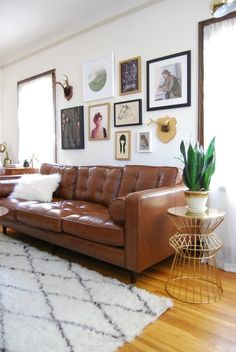 over the sofa gallery wall. Love the leather tufted sofa as well!