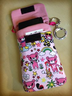 """Designed to be as useful and awesome as possible, this """"purselet"""" (purse/wallet) is a great accessory for you or a Gloomy Bear-loving friend! Fully lined and padded for security, this has a main pocket (7.25"""" x 4.5"""") that will fit any smart phone (including the massive Galaxy Note) or small elect..."""