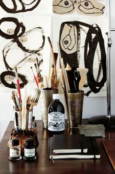 this is totally up my alley, item-wise. moleskins, black ink and an assortment of brushes in funky holders