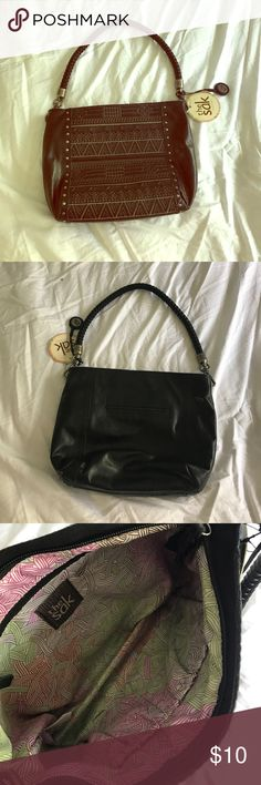 Leather purse Brand new with tags. Very cute. Has a design on the front. The Sak Bags Shoulder Bags