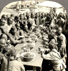 A HAPPY, HUNGRY CROWD AT A BEIJING OPEN-AIR RESTAURANT in OLD CHINA
