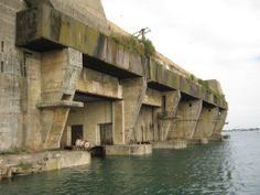 Of Brutalist cliffs and silent maws. German Submarine pens at Lorient, Brittany, France. Bunker, German Submarines, Fortification, 3d Max, Brutalist, War Machine, Military History, World War Two, Abandoned Places