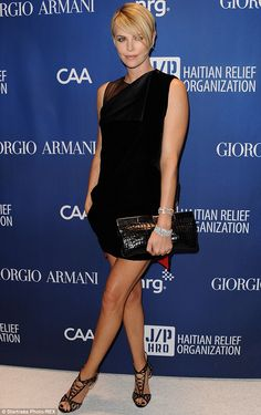 Natural born charmer: Charlize Theron, pictured in January, is gearing up to return as hos...