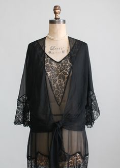 Vintage 1920s Black Lace and Chiffon Flapper Dress & Jacket $348.00 Lovely black silk lace and chiffon. The dress has a classic flapper silhouette with a loose fit. The jacket has a open front with a tie waist and fluttery sleeves.