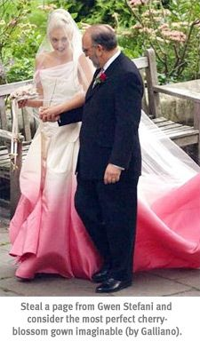 Gwen Stefani's wedding dress with its edges of pink fits the cherry blossom wedding feel well