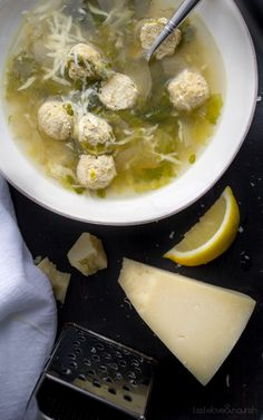 This Italian Wedding Soup, made with chicken, is light and healthy, but so delicious with buttery Parmesan and a bit of fresh lemon.   @tasteLUVnourish   #soup