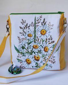 Сумка из Водоотталкивающей ткани Art collection Chamomile.  По просьбе некоторых клиентов я буду создавать не только рюкзаки-сумки. Не все же носят рюкзачки, хотя на мой взгляд, это самая удобная вещь.  Новая сумочка с ручной реалистичной росписью. Ромашки прекрасны🥰  Можно приобрести и брошь жук, который удачно сочетается с сумкой.  Сумка размер: 26:22:11 Ткань: водоотталкивающий дак Длина ручки 68 см Фурнитура высшего качества. Цена 650 грн.  Брошь жук Цена 600 грн.  #сумкаарт… Bags, Fashion, Handbags, Moda, La Mode, Fasion, Totes, Hand Bags, Fashion Models