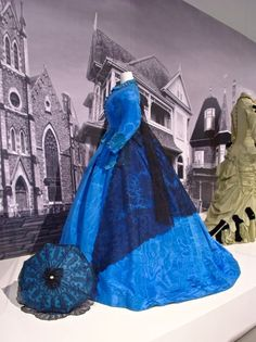 Blue moire silk with lace shawl and matching parasol, c.1862
