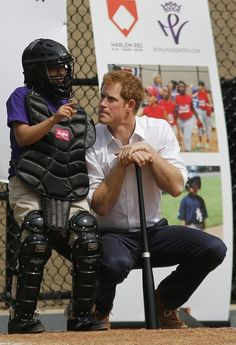 That time he asked a small child for tips on how to hit a baseball. | 21 Most Swoon-Worthy Moments Of Prince Harry's Visit To America