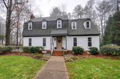 Dutch Colonial home in Virginia Beach.  Gabled dormers.  Traditional tall, narrow sash windows in a six-over-six pattern.