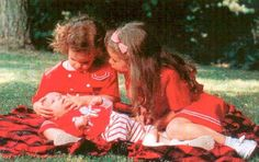 Princesses Marie-Astrid, left, and Maria-Annunciata of Liechenstein admiring new baby brother, Prince Josef-Emanuel.