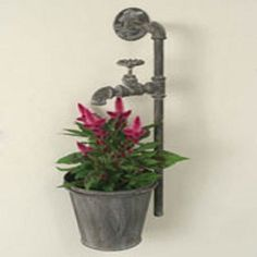 """Water Spigot """"Wall Planter"""" ~ made from plumbing parts and looks great mounted on a fence. 7"""" flower pots are included. This piece measures 20½"""" long, 10"""" deep and 11"""" tall. Available in Single for $29.99 or Double for 36.99."""