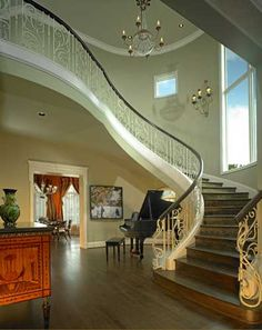 D Home Magazine's Showhouse Home designed by Nancy Anderson Ross, Dallas Design Group Interiors, and built by Sharif and Munir Custom Homes, with Regency Railings iron staircase.