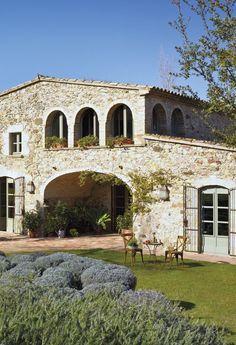Old Spanish farmhouse-love the idea of building an open garage area(more like a carport) like this opening. veranda above could be the bedroom windows.