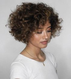Voluminous Short Curly Bob Your short, naturally curly hair will look incredible with a poofy jaw-length bob. Part your thick, wide curls to the side or in Curly Hair Cuts, Short Hair Cuts, Curly Hair Styles, Thin Hair, Short Curly Pixie, Long Curly, Side Curls, Medium Bob Hairstyles, Cute Short Curly Hairstyles