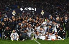 The Real Madrid players celebrate with the trophy after the UEFA Super Cup match between Real Madrid and Sevilla FC at Cardiff City Stadium on August 12, 2014 in Cardiff, Wales.