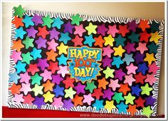 Cut out 100 stars to go on bulletin board