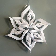 Step by step photo tutorial for making giant paper snowflakes: great for Christmas or a Frozen party