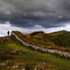 """A hiker walks along Hadrian'S Wall in England. The Wall's construction was begun in 122AD and finished in six years. The wall, which was named after the Roman Emperor Hadrian runs 80 Roman miles across the entire width of England. The construction according to one biographer of Hadrian was """"to separate the Romans from the barbarians"""" @RobertClarkphoto @thephotosociety @Natalie Brewer"""