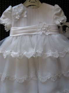 Sarah Louise Gown in white with layers of lace and organza - close up view of bodice