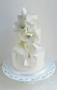 Just pure white wedding cake and crystal