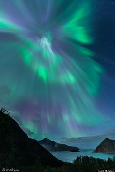 """NASA PHOTO  Aurora """"Wormhole"""" Opens over Norwegian islands of Kvaloya stunning aurora corona is caused by the angle at which the solar radiation hits the atmosphere of the planet"""