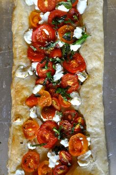 Fresh tomatoes, feta cheese (or maybe goat?) and  herbs on a good bread. Wonderful!