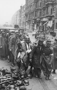 "Captured German soldiers come out of the metro station ""Oranienburger Tor» (U-Bahnbahnhof Oranienburger Tor) after the surrender in Berlin."