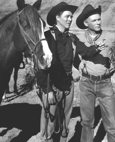 WAGON MASTER (1950) - Ben Johnson (left) - Joanne Dru - Harry Carey Jr. (right) - Ward Bond - Charles Kemper - Alan Mowbray - Jane Darwell - Directed by John Ford - RKO-Radio Pictures - Movie Still.