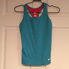 Nike tank with built in bra Perfect for anything involving a lot of physical activity! So comfortable! Worn once! Perfect for summer! Has a built in bra in it so it is convinent!! Nike Tops Tank Tops