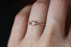 This blush beauty is just lovely! Prefect for everyday wear. This ring would also make a great promise ring, or dainty engagement ring, for the girl who wants some beautiful and simple. Oval Morganite measures - Diamonds measure each Band measures round. Pear Shaped Engagement Rings, Wedding Rings Solitaire, Gemstone Engagement Rings, Champagne Ring, Expensive Wedding Rings, Expensive Rings, Oval Morganite Ring, Morganite Jewelry, Sapphire Diamond Engagement