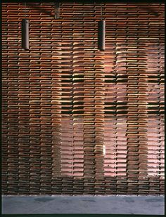 Reclaimed terracotta roof tiles as facade. By architect Arturo Franco.