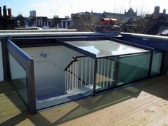 2 wall mounted Sliding Box  The Sliding box rooflights are a great option for terraced access as it offers a physical structure and the fixed walls of glass provide a balustrade around the opening. It also allows you to continue your handrail right up to the point of leaving the box and stepping onto the roof terrace.