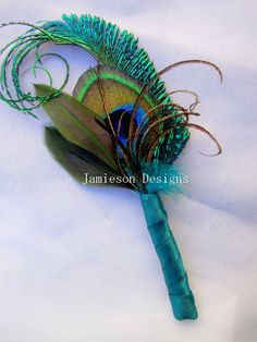 Peacock Wedding Decorations | Teal Peacock Feather Boutonniere | Wedding Ideas