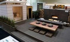 Delectable Backyard Furniture Design Ideas With Wooden Deck And Wicker Sofas Also Built In Fireplace And Rectangle Shape Outdoor Dining Table Also Tufted Floor Seats Pool Furniture Patio Furniture Denver, Great Design Ideas Of Backyard Furnitures: Furniture