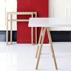 Collapsible Sawhorse Table - West Elm. I like the concept, but I think you could make the folding legs for really cheap and add a painted board or old door