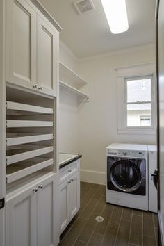 "Laundry Room Design Ideas, Pictures, Remodels and Decor ---this is fancier with mesh ""drawers"" for drying flat"