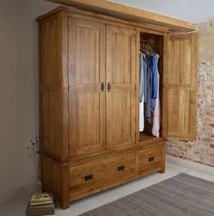 The Original Rustic Solid Oak Armoire is a stately and robust addition to a traditional bedroom.