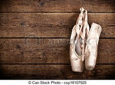 Old used pink ballet shoes hanging - csp18107925