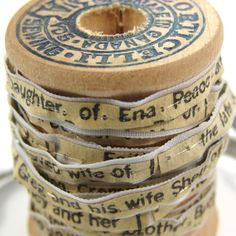Spool Of Life Detail, 2012, 5 H x 5 W x 5 D cm, Wooden Spool, Ribbon, Thread, Mothers Obituary