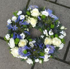 Funeral Wreath with Roses, Thistles and Agapanthus in whites and purples Funeral Flower Arrangements, Funeral Flowers, Floral Arrangements, Flower Wreaths, Flower Bouquets, Floral Wreath, Wedding Wreaths, Wedding Flowers, Remembrance Flowers