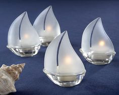 "Frosted Glass Sailboat Tealight Favor (set of 4), $22.60, buy volumes & save big, plus get free ground shipping on orders of $79+, use code ""delivery free"" at checkout. (http://www.firstavenueweddingfavors.com/frosted-glass-sailboat-tealight-favor-set-of-4/) #beachthemedfavors"