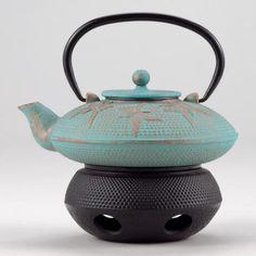 (Cast iron tea pot warmer, uses tea candle; frm WorldMarkets; rrj 122814 end)