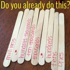 love this idea!  labeled popsicle sticks to practice place value!!  store each set in a snack-sized baggie.